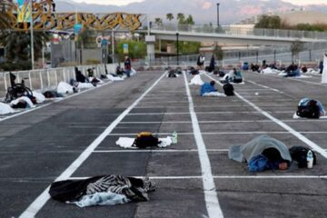 In Las Vegas, Homeless People Sleep 6 Feet apart in Parking Lot as Thousands of Hotel Rooms Sit Empty