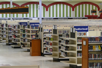 A Stunning Supermarket-Turned-Library Features Aisles & Freezers Stocked with Books