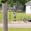 Boys Hop Off their Bikes to Pay Respects during Veteran's Funeral
